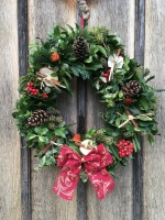 Fresh Christmas Wreath with red Swirl Bow